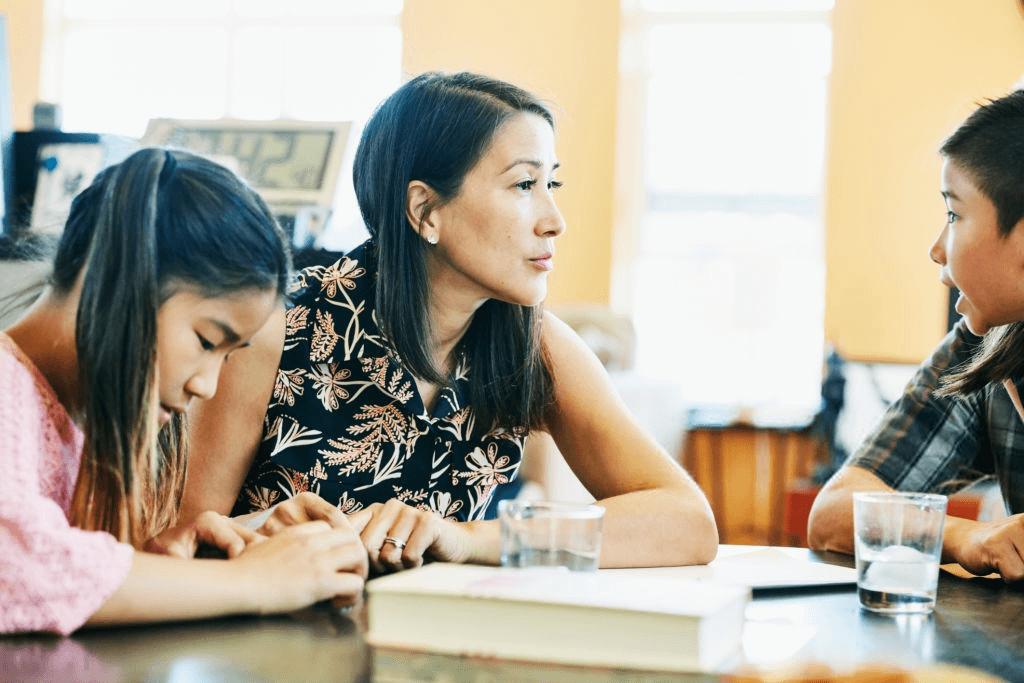 Mother homeschooling kids